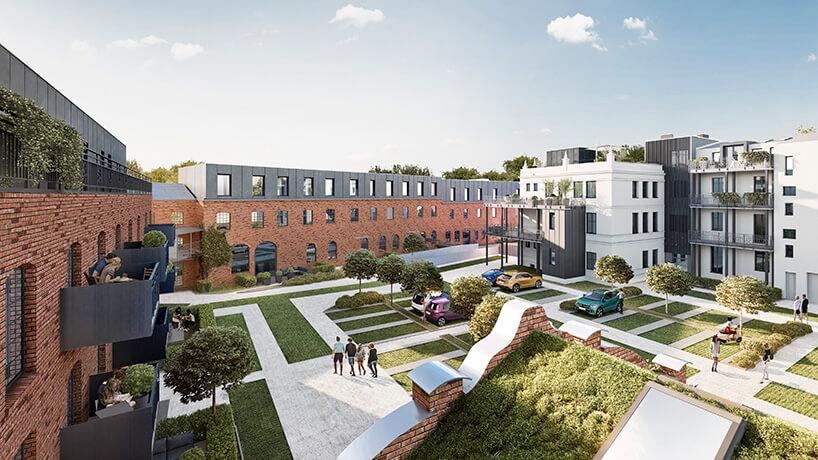 biały budynek wsąsiedztwie zieleni oraz loftowych budynków zczerwonej cegły