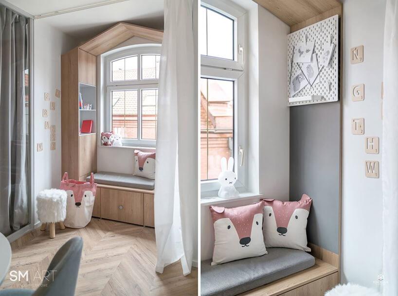 biało szary pokój dla dziewczynki zzabudowaną przestrzenią wokół okna zszarym siedziskiem