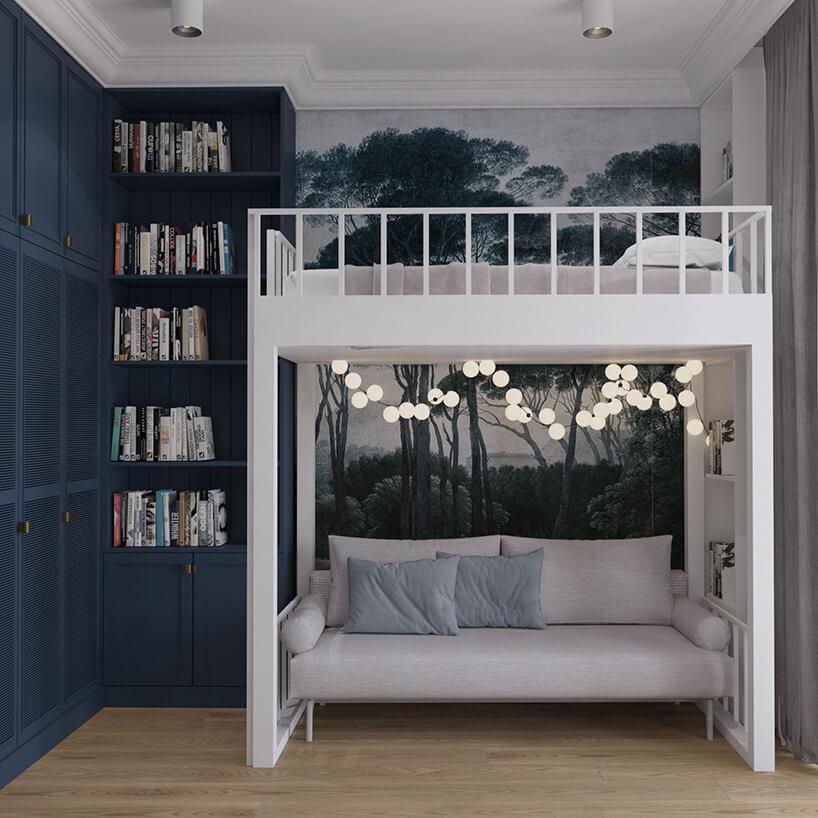 piętrowe białe łóżko zkanapą na dole wpokoju zciemno niebieskimi ścianami