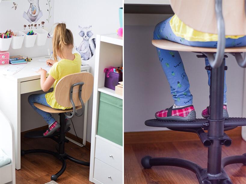 dziewczynka siedząca przy biurku na krześle Casper od Kinnarps zpodparciem na stopy