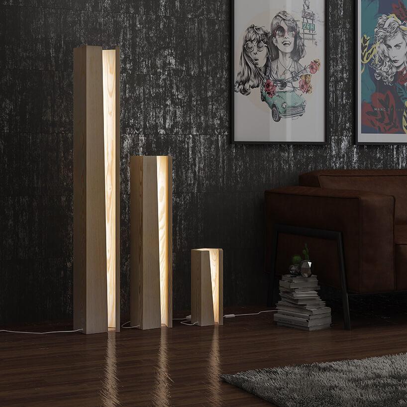 trzy rożnej wysokości drewniane lampy