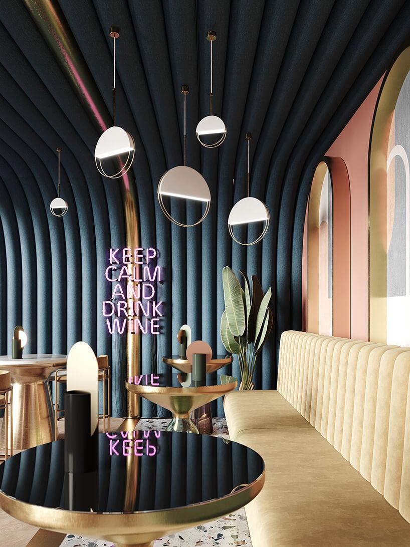 wyjątkowe lampy od Ilumni ze złotymi okrągłymi prentami połowicznie wypełnione lampą wciemnym plisowanym wnętrzu restauracji