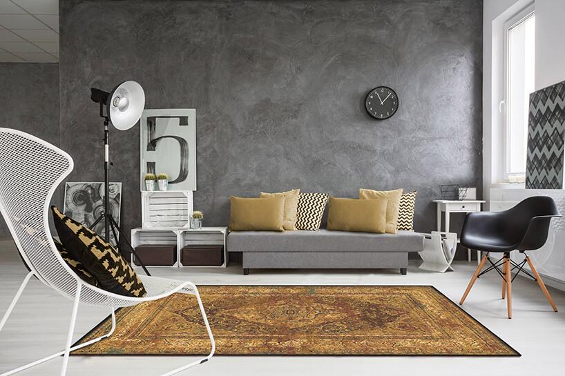 szare wnętrze zpięknym dywanem wełnianym