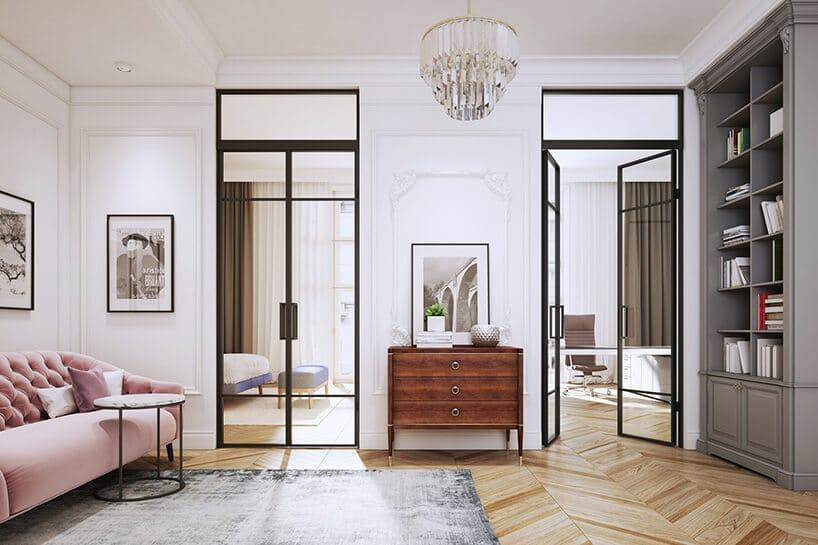 salon zpudrowo różową kanapą istarą podłogą oraz dwoma wejściami zloftowymi drzwiami