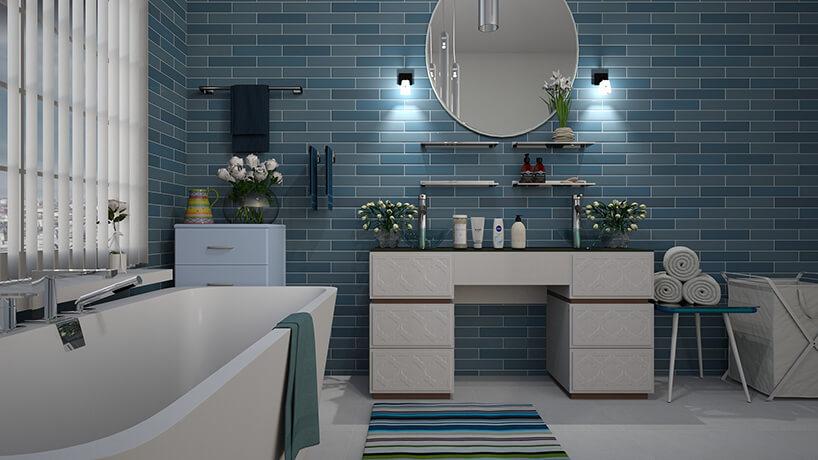 nowoczesna łazienka zniebieskimi płytkami wkształcie cegły na ścianie zdużą białą wanną