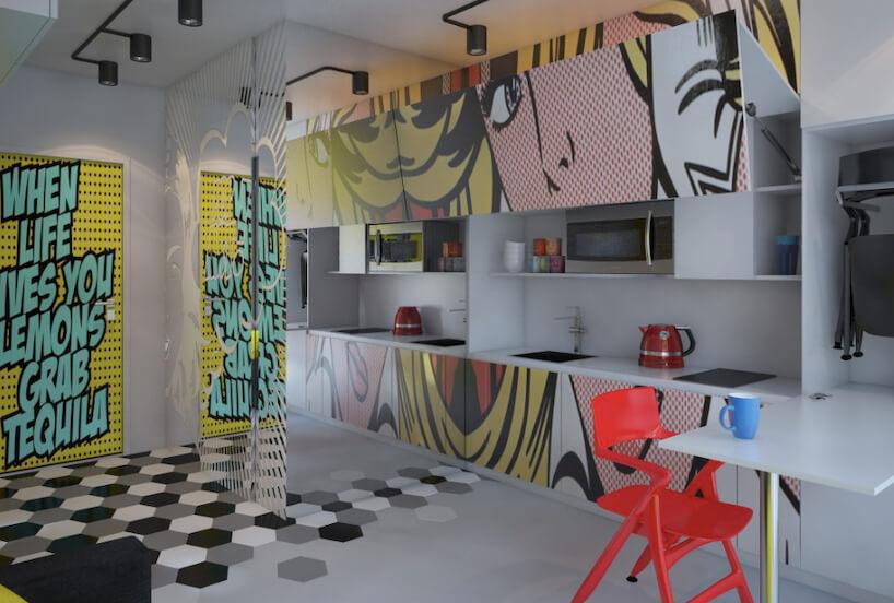 kuchnia pop art projektu pracownia Beautiful Minds Design podłoga zszarych, białych iczarnych sześciokątnych płytek imotywem komiksowych postaci na frontach szafek