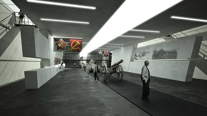 wnętrze muzeum zmałą szarą armatą