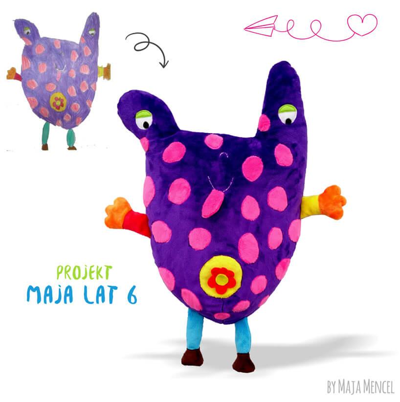 fioletowa maskotka wzorowana na rysunku dziecka