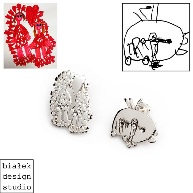 srebrne kolczyki obok rysunku dziecka