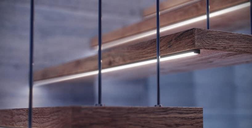 delikatne profile led pod drewnianymi ciemnymi schodami