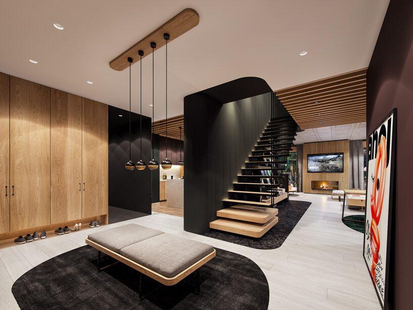 projekt nowoczesnego wnętrza domu od Zarysy hol zjasną podłogą zcentralnym szarym siedziskiem idrewnianymi schodami na piętro