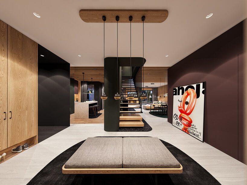 projekt nowoczesnego wnętrza domu od Zarysy hol zbrązową ścianą idrewnianą zabudową