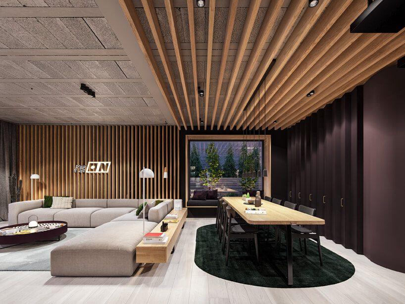 projekt nowoczesnego wnętrza domu od Zarysy jadalnia zjasną podłogą dużym stołem zdrewnianym blatem obok szarej modułowej sofy