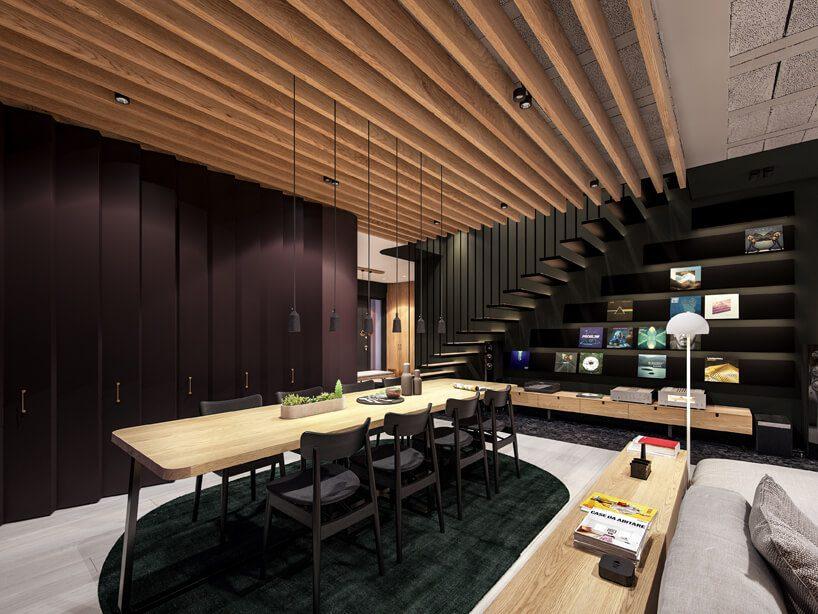 projekt nowoczesnego wnętrza domu od Zarysy jadalnia zczarnymi krzesłami idużym stołem zdrewnianym blatem