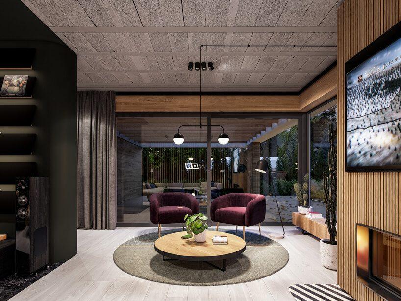projekt nowoczesnego wnętrza domu od Zarysy dwa bordowe fotele przy niskim okrągłym stoliku na szarym okrągłym dywanie