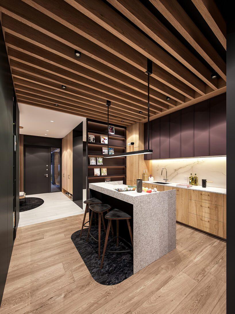projekt nowoczesnego wnętrza domu od Zarysy drewniana kuchnia zmałą wyspą wykończoną jasnym kamieniem na drewnianej podłodze