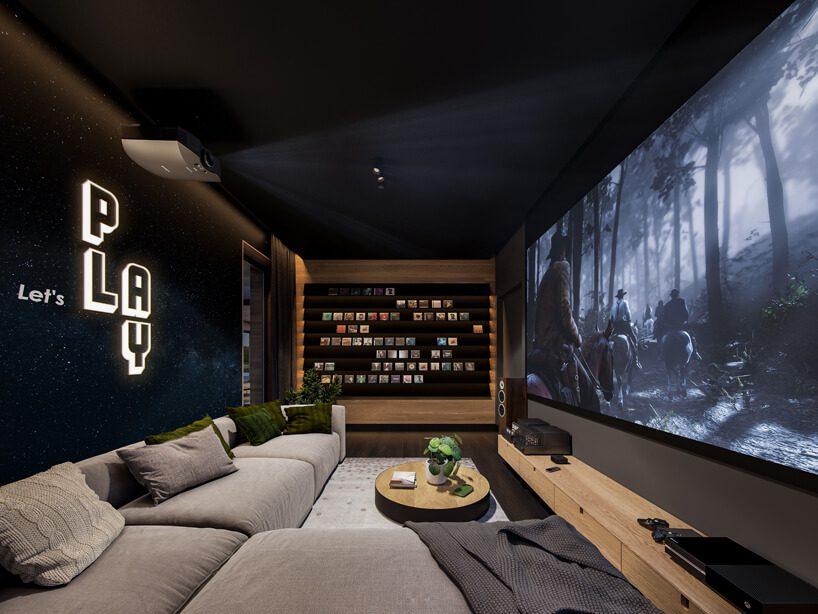 projekt nowoczesnego wnętrza domu od Zarysy ciemna sala kinowa zdużym ekranem imodułowa szarą sofą