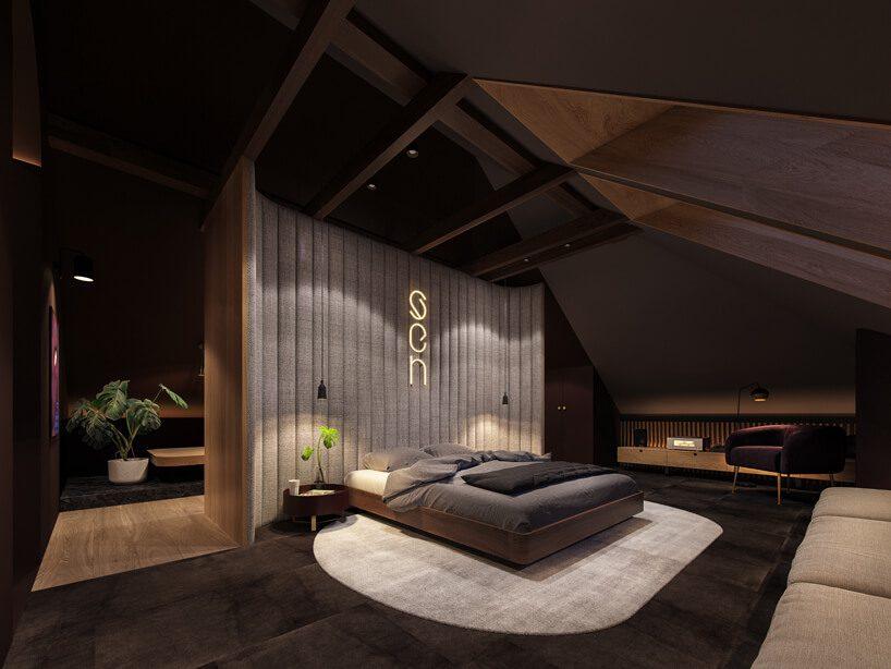 projekt nowoczesnego wnętrza domu od Zarysy ciemna sypialnia zczęściową opadającym drewnianym sufitem