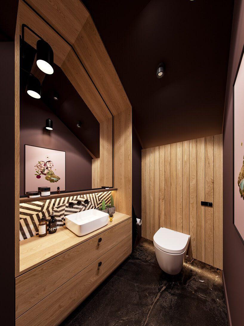 projekt nowoczesnego wnętrza domu od Zarysy łazienka zjasną drewnianą zabudową zbrązowymi ścianami iczarną kamienną podłogą