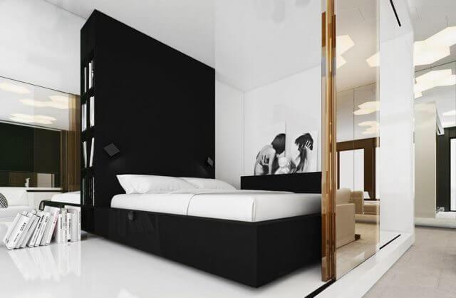 duże brązowe łóżko przy wysokiej szafce