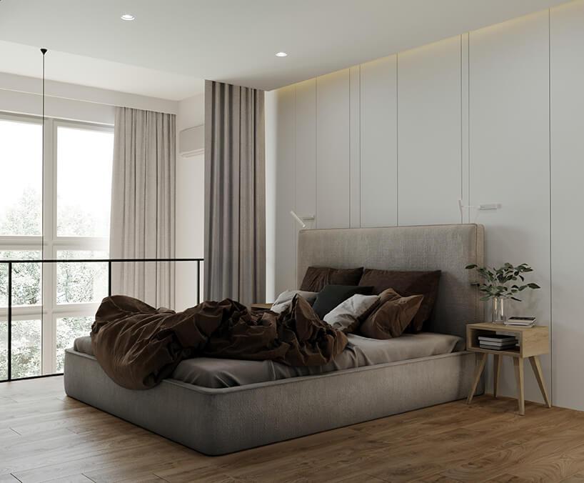 szarawe łóżko na zbrązową kołdrą oraz poduszkami obok retro szafeczki nocnej
