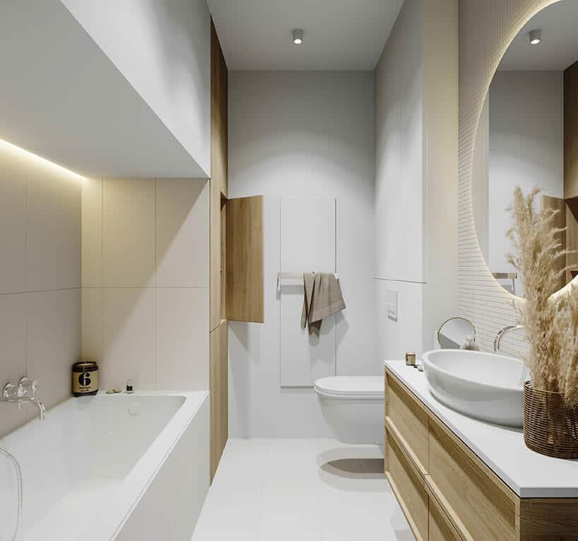 przestronna łazienka zduża wanna oraz drewnianymi akcentami iścianą ze sztukaterią
