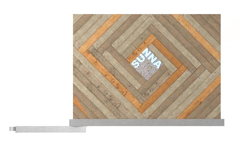 mobilna sauna od MRSatelier lewy bok sauny zdrewnianych paneli zlogo pośrodku