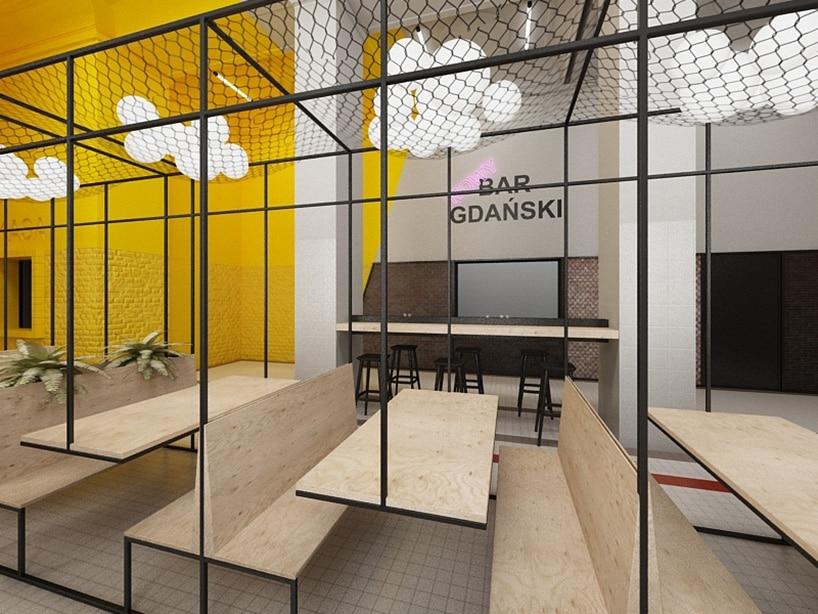 nowoczesne wnętrze zżółtym kolorem metalową konstrukcja oraz siedziskami zforniru