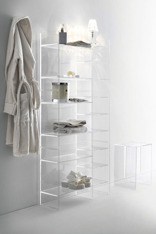elegancka transparentna szafka istołek od Kartell by Laufen wjasnym pomieszczeniu