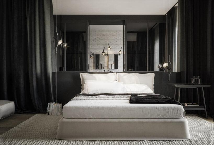 duże łóżko zczarną narzutą