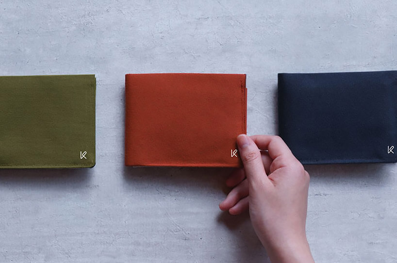 trzy materiałowe portfele