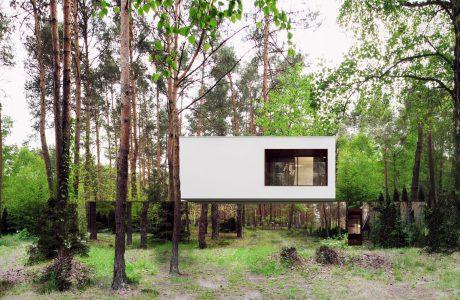 biały dom ze szklaną fasadą na dole