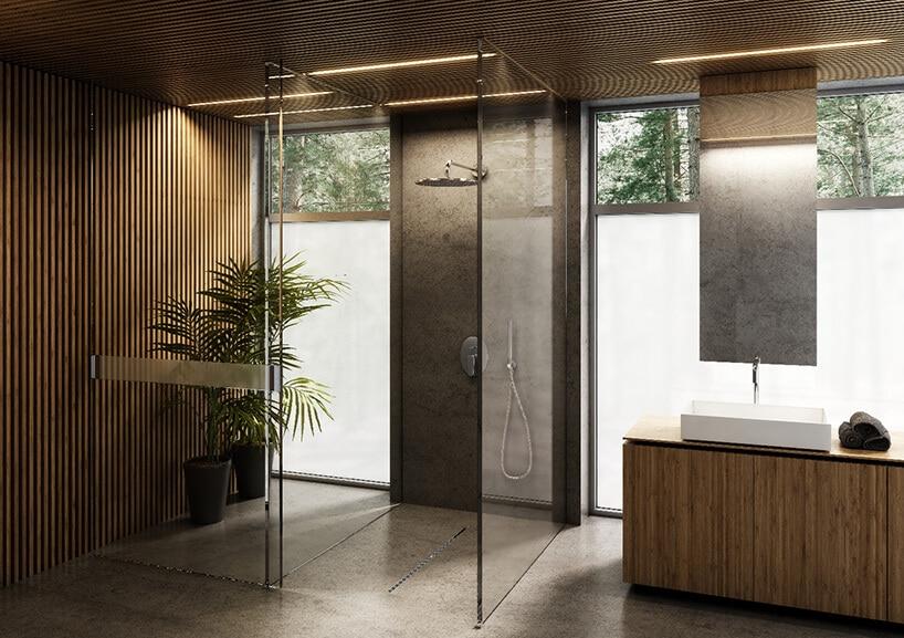 drewniane wykończenie łazienki ze szklanym prysznicem oraz betonową podłogą