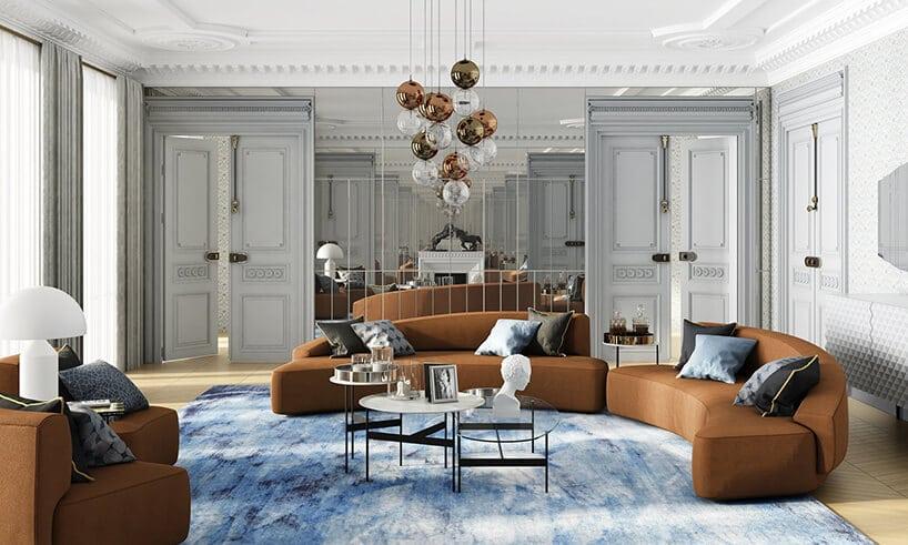 wnętrze salonu zdużą kanapą wkształcie bumerangu wkolorze ciepłego brązu