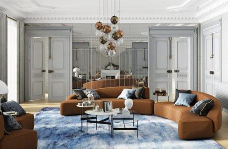 wnętrze salonu z dużą kanapą w kształcie bumerangu w kolorze ciepłego brązu