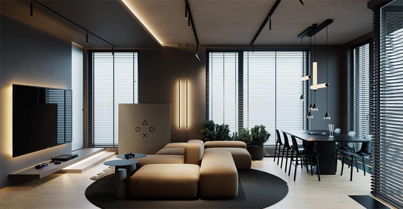 nowoczesny salon zjadalnią zwyjątkowym siedziskiem pośrodku obok czarnego stołu zczaarnym krzesłami
