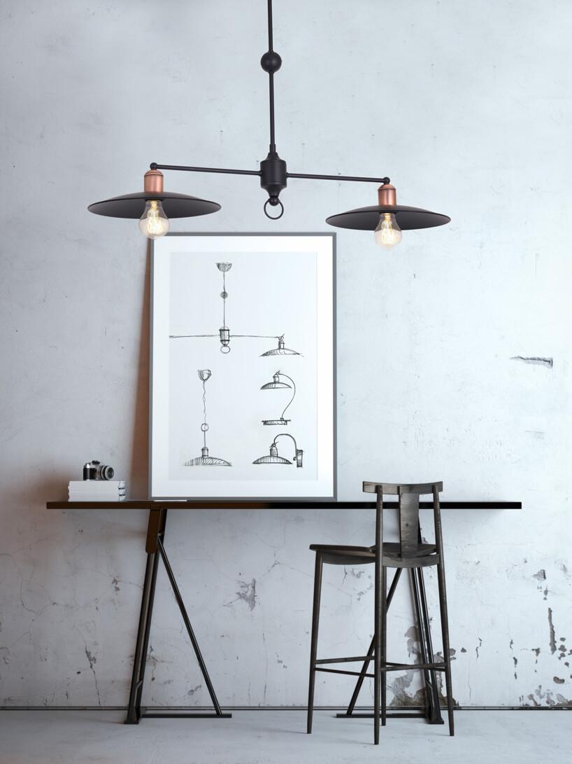 nietypowe półka ze stojącym na niej obrazem pod podwójną lampą wiszącą