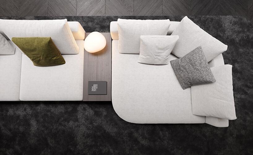 kanapa narożnik zbiałymi poduszkami iświecącą kulą