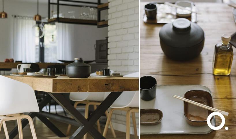 zestawienie stołu wjadalni zgrubym drewnianym blatem znaczyniami wstylu japońskim