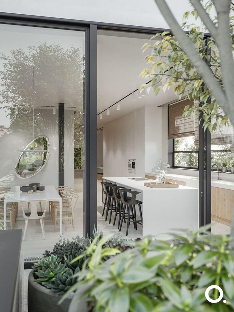 widok bez panoramiczne okna na białą kuchnię połączoną zjadalnią