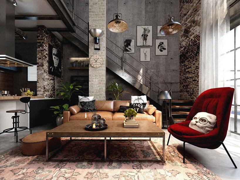 czerwony aksamitny fotel welurowy wpomieszczeniu zbetonem na ścianach oraz dodatkami zdrewna
