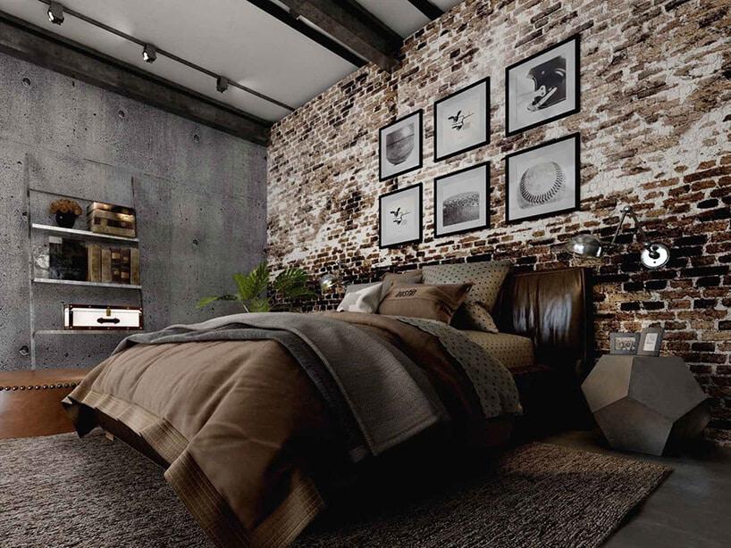 stara ponadpalana cegła na ścianie zobrazkami wramkach przy dużym łóżku wsypialni zszarym betonem