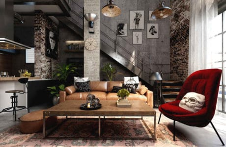 czerwony aksamitny fotel welurowy w pomieszczeniu z betonem na ścianach oraz dodatkami z drewna