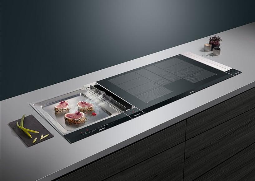 nowoczesna kuchnia zmożliwością smażenia na kamieniu grzewczym wraz zkuchenką indukcyjną