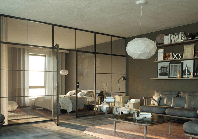 sypialnia oddzielona od salony szklaną ścianą działową