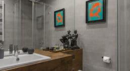 elegancka nowoczesna kamienica wjasno szarych barwach zelementami szkła