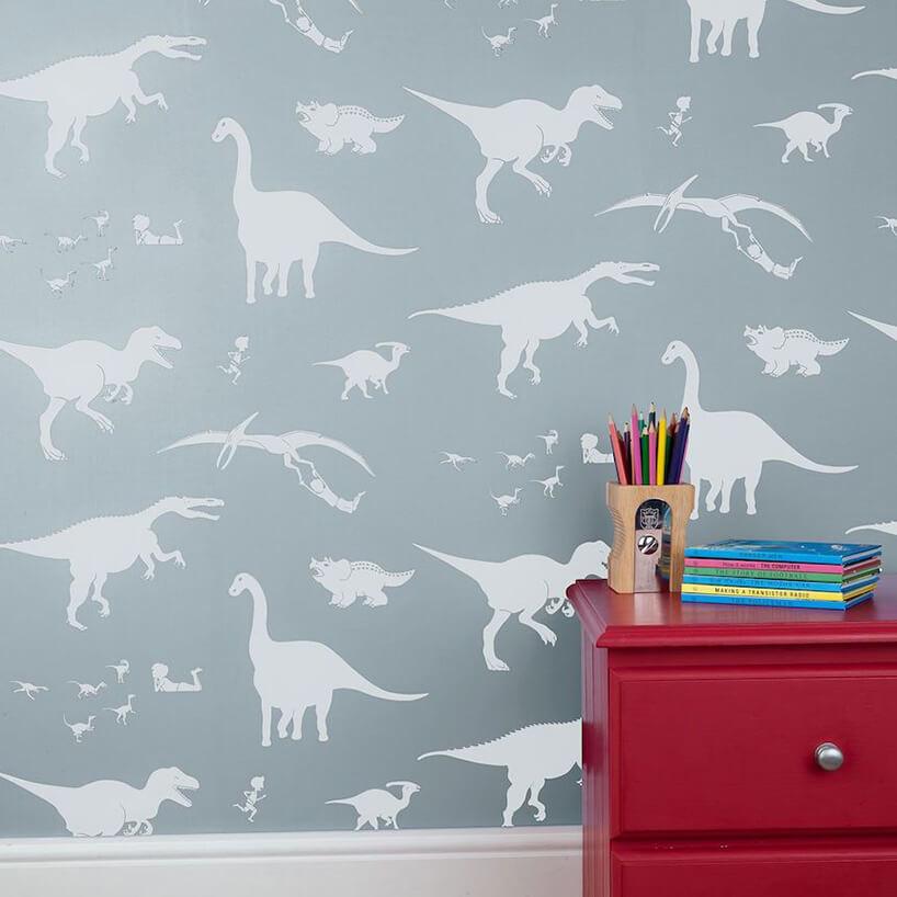 wyjątkowa tapeta do pokoju dziecięcego białe zarysy dinozaurów na szarym tle