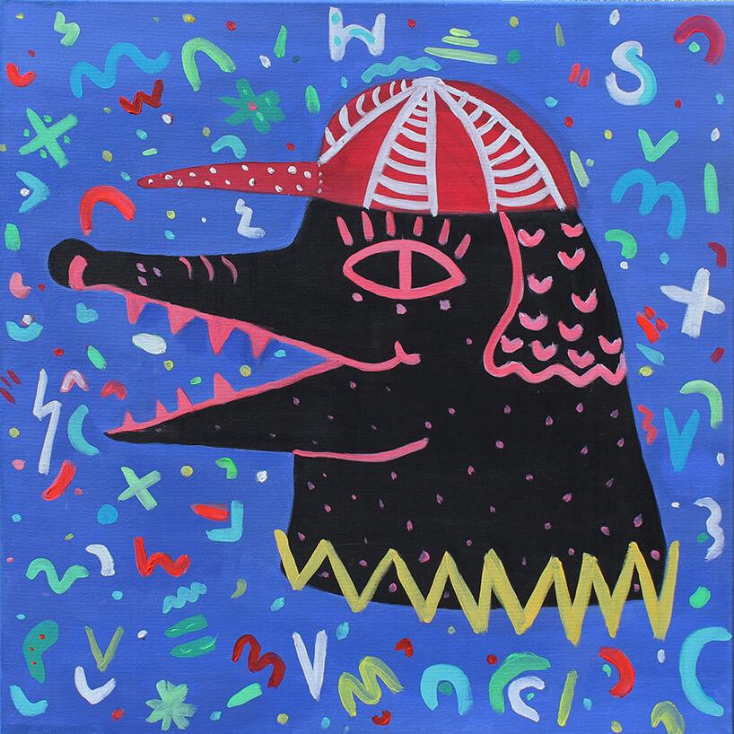 obraz czarnego krokodyla na fioletowym tle zróznymi znaczkami