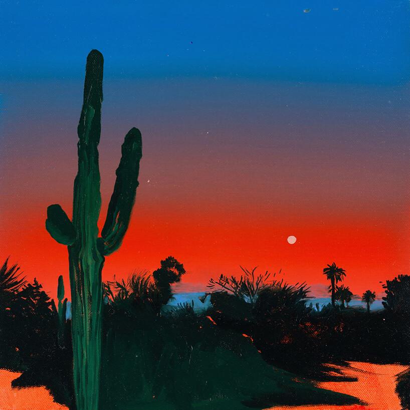obraz pustyni zdużym kaktusem iczerwono niebieskim niebiem