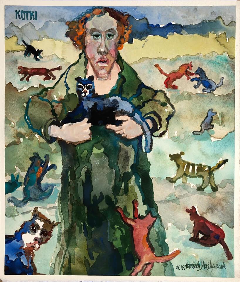 obraz mężczyzny pośród kotów